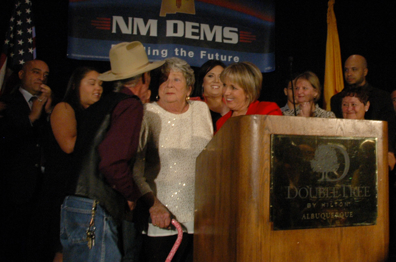 Michelle Lujan Grisham and her mother, Sonja Lujan, celebrate Lujan Grisham's win with Lorenzo Candalaria Tuesday, Nov. 4, 2014, at the Doubletree Hotel in Downtown Albuquerque. Grisham won the race for Congress 58% to 41% against the Republican candidate Michael Frese. (Emily Ediger/NM News Port)