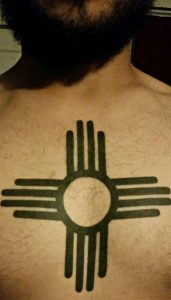 Owen Schwav got the Zia symbol tattooed on his chest after moving to Albuquerque. Photo by Mariah Rimmer / NM News Port