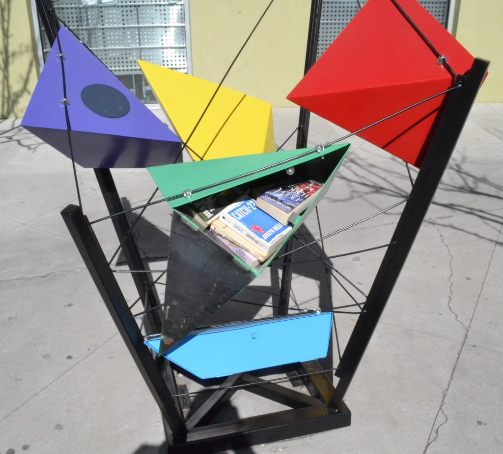 One example of the Little Free Library was built earlier this year outside of the Talin Market. This design, done by Erica Aragon, won first place in UNM's School of Architecture library design contest. Photo by Derrick Toledo / NM News Port