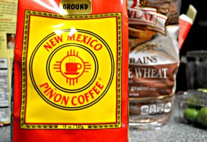 The packaging for New Mexico Pinon Coffee's bag of ground coffee showcases their logo: a coffee mug inside of a Zia symbol. Photo by Veronica Munoz-De La Cruz / NM News Port