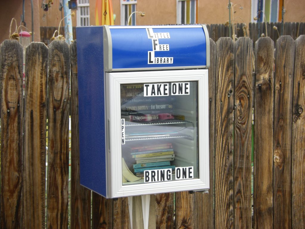 This little free library near Aztec and 4th Street NW is made out of an old refrigerator. Photo courtesy of Robert Shipley.