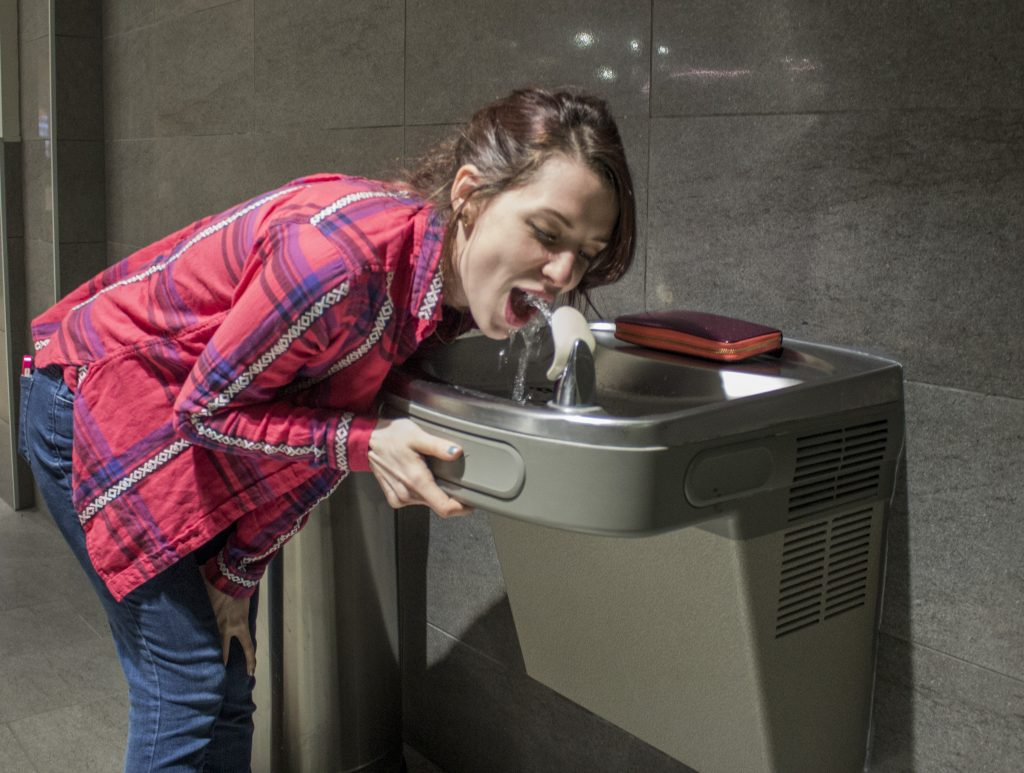 """""""Water fountain Lang""""                                                                               Photo by Evan Barela Hannah Lang drinks from a fountain carrying water from the Albuquerque Bernalillo County Water Utility Authority."""