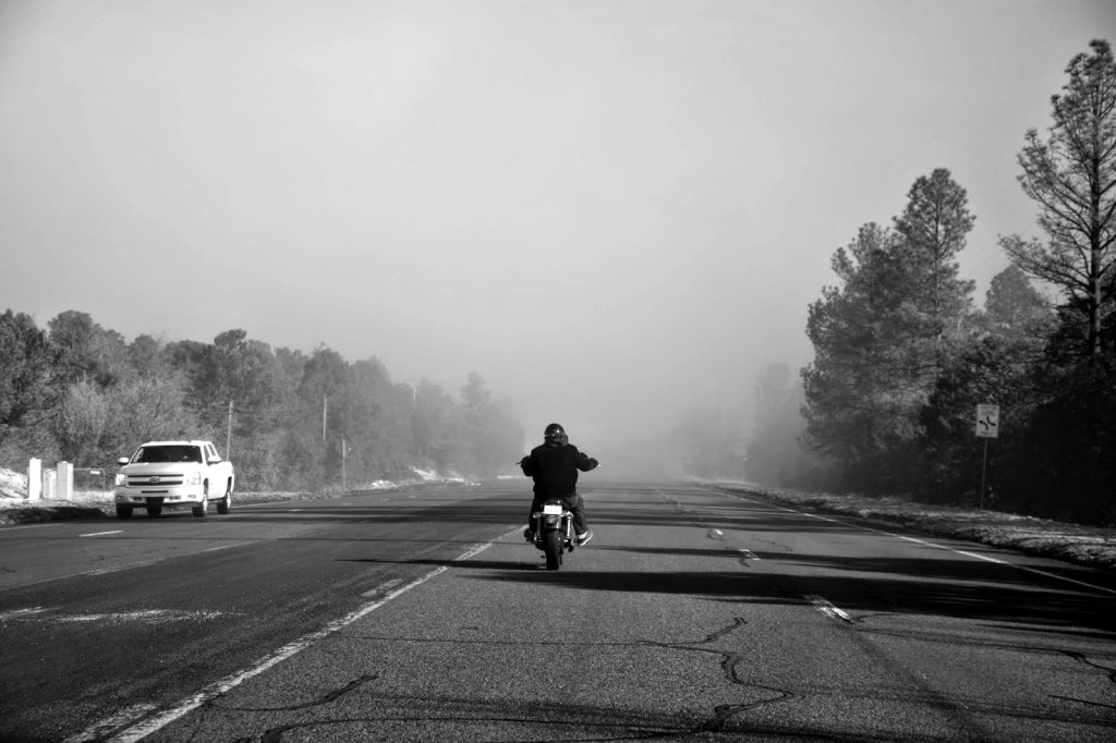 Nick Fojud rides into the early morning fog towards Madrid, NM Sunday, Feb. 1, 2015. Photo by Emily Ediger / NM News Port