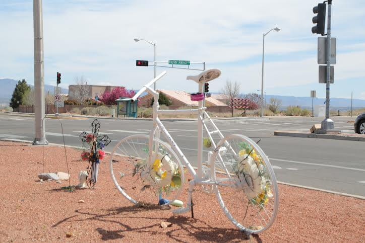 On the corner of Taylor Ranch Rd. and Montano Rd. stands the ghost bike commissioned in memory of Reece Nord. Nord, who was 14 at the time of his passing, was struck by a drunk driver while riding his bike. Photo by Jaclyn Younger / NMNP