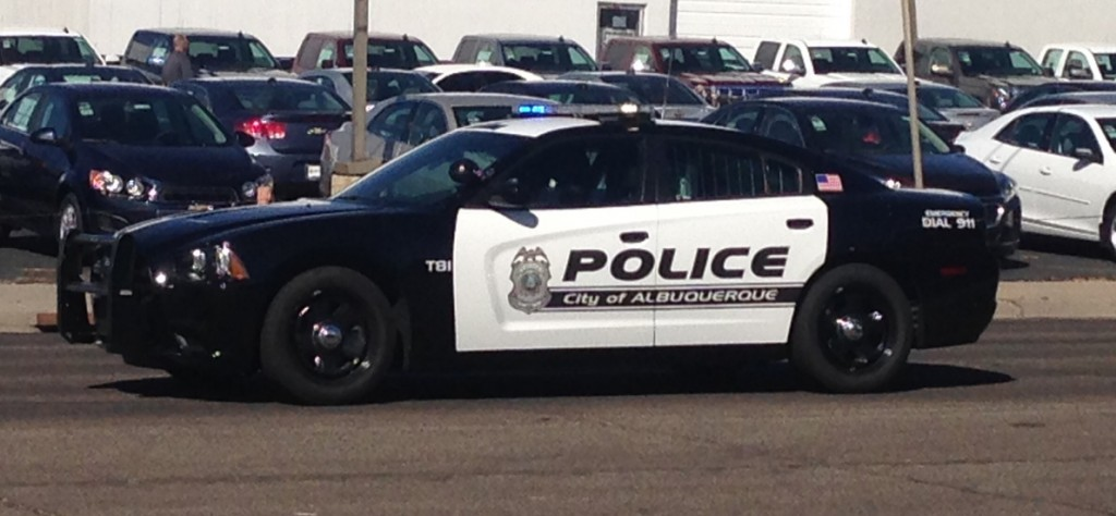 In 2011 APD switched to a vintage black and white paint scheme using Dodge Chargers as the new squad cars.  Photo by Kenneth Ferguson/ NM Newsport