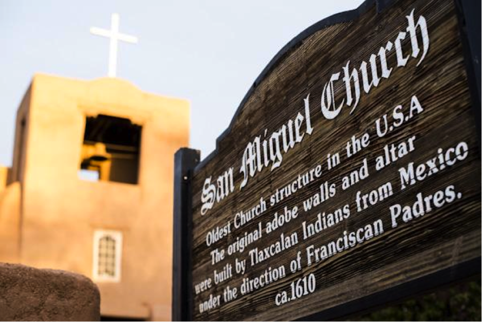 The sign of the San Miguel By Nick Fojud Church, describing the mission as not only the oldest in the state, but the oldest in the U.S. Sunday April 12. Photo.