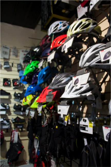A variety of helmets are sold at The Bike Coop near the UNM Campus. They come in different sizes, styles and colors. Photo by Nayla Degreff.