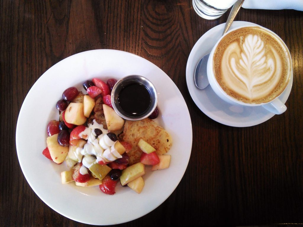 The Grove Cafe and Market offers pancakes with a crepe-like texture, topped with whipped cream, maple syrup, and tons of seasonal fruit. Photo by Veronica Munoz/NMNP