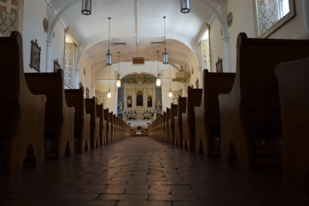The rows of pews in the San Felipe De Neri Parish, one of the oldest structures in Albuquerque, located in Old Town. April 17, 2015. Photo by Emily Ediger / NMNP