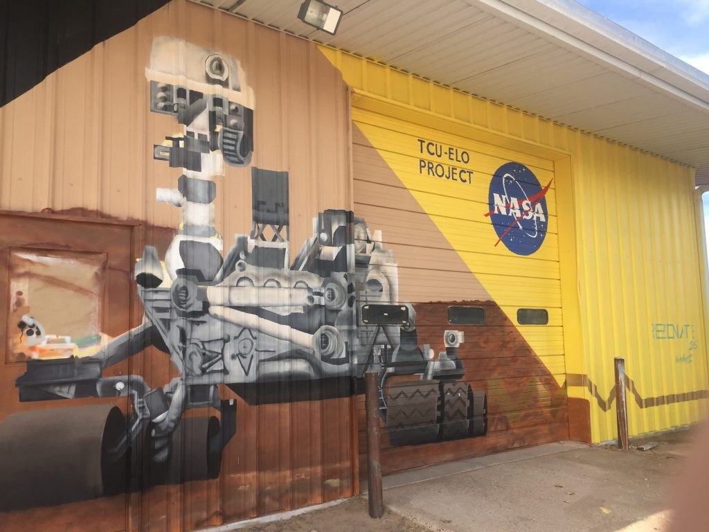 Mural of a rover painted on the side of the main Mars yard warehouse. (Photo by Elaine Baumgartel/KUNM)