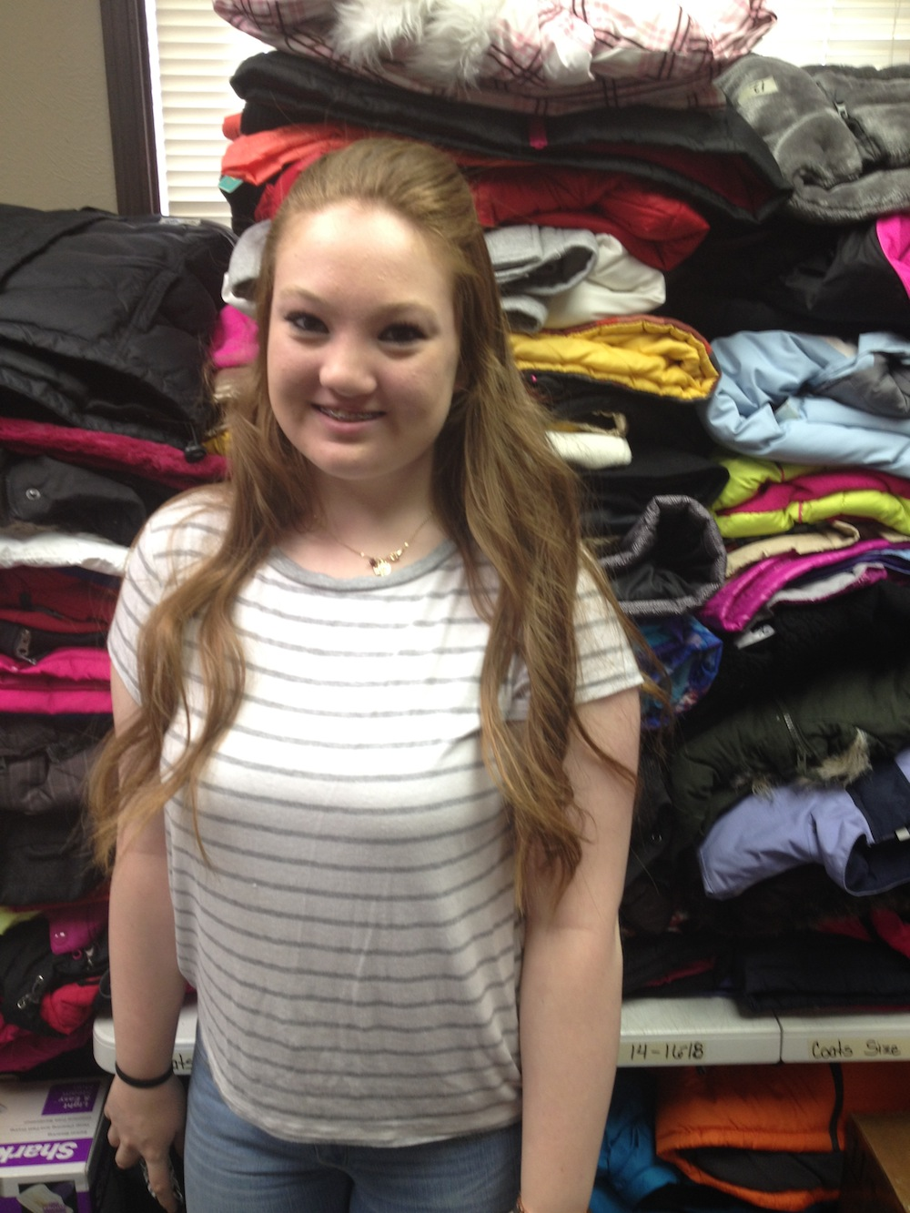 14-year-old Katie Dunavan volunteers at Locker #505. Volunteers make up the majority of the organization's workforce; apart from Kerschen, there are only two part-time employees working for Locker #505. Photo by Brenna Kelley/ NM News Port