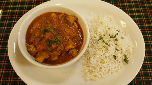 The Swahili chicken curry stew served with coconut basmati rice is a signature menu item at Karibu Café. Photo by Alicia Padilla / NM News Port.