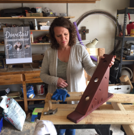 """Erin O'Donnell shows off a past """"Brew and Build"""" project, which was a wine bottle holder. O'Donnell picks different projects for each Brew and Build event. Photo by Alisha Barber / NM News Port"""