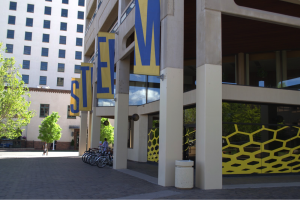 "The STEM banners hang from the STEMulus center as the ""honeycomb"" design quickly draws your attention in. The STEMulus Center is located in the plaza near the Downtown Sports and Wellness Center. Photo: Monique Rinaldi/ New Mexico News Port"