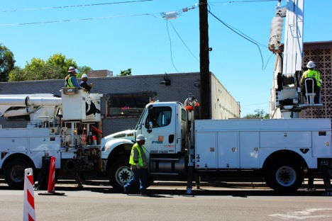 City workers doing construction work right outside of a local business, near Central and 10th.