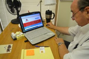 Frank Ruvolo updating the Bernalillo County Republican Party's Website. Ruvolo keeps Bernalillo county Republicans aware of events and updated on news about the Republican party through the website. Photo by Natalie Baca / NM News Port