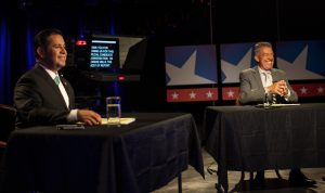 Preparing to debate on NMPBS: Ben Ray Luhan (L) and Michael Romero (R). Photo by Kevin Maestas / NM News Port