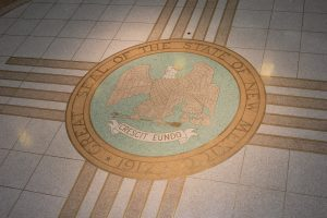 State Seal on the floor of the NM State Capitol. Photo: Amanda Nezzie / People, Power & Democracy Project
