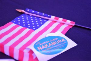 Justice Judith Nakamura wins the NM Supreme Court Race. Stickers and miniature U.S flags covered tables at the Republican Party on election night. (Photo taken by Allison Giron)