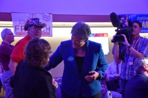 Nakamura talks with excited Republican attendees while waiting for the results of the race. (Photo taken by Allison Giron)