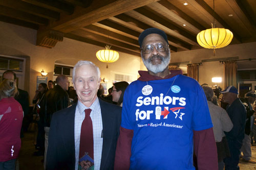 Charles Power (Left) and John Comstock (Right) show their support for Hillary Clinton at the Election Party. The Democratic watch party was held at the Hotel Andaluz. Photo by Mercedez Holtry / NM News Port