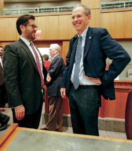 Rep Brian Egolf, left, talks to Sen. Peter Wirth, right, shortly after the special legislative session in October. Both men are up for house leadership positions.