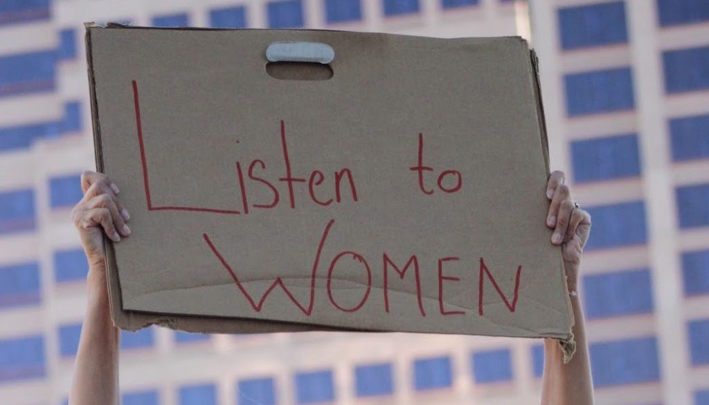 sign saying listen to women