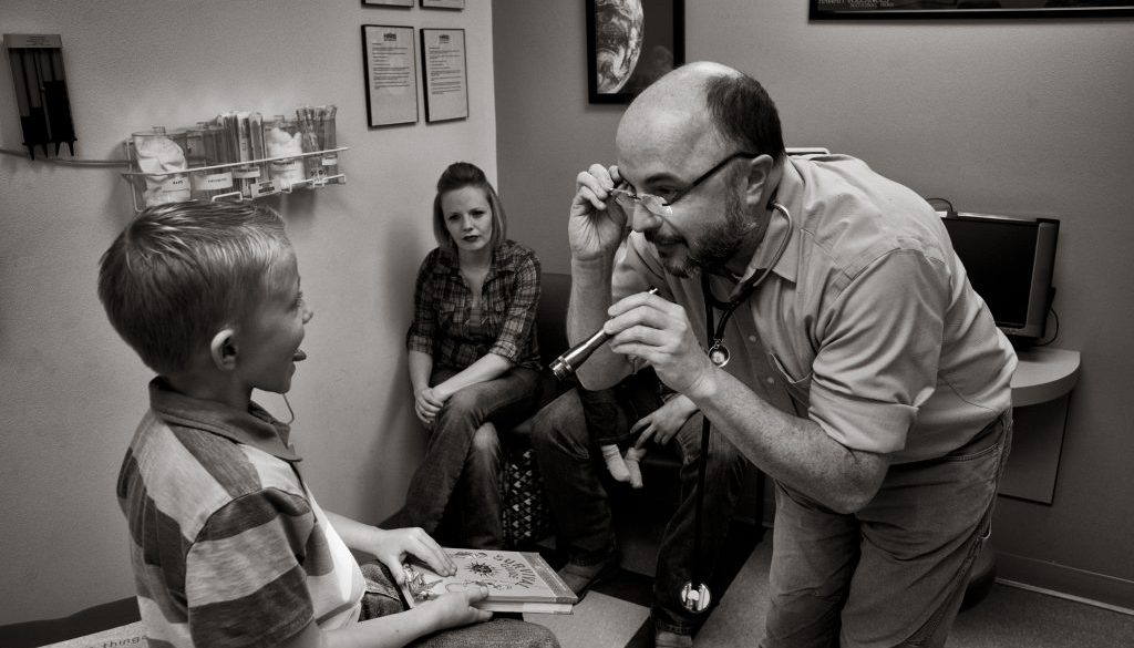Dr. Brian Ehteridge seeing patients in his office in Silver City.