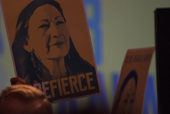 Supporters wave campaign posters from Democrat Debra Haaland while giving her victory speech for the U.S House of Representative seat on Tuesday night at Hotel Albuquerque. Photo By Amy Byres/ NM News Port
